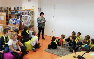 Prvošolci spet na obisku v knjižnici